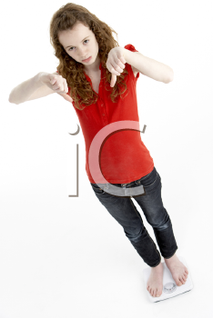 Royalty Free Photo of a Girl on Bathroom Scales Giving a Thumbs Down