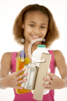 Royalty Free Photo of a Young Girl With Recyclables