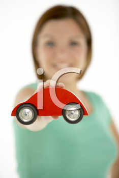 Royalty Free Photo of a Woman With a Tiny Car
