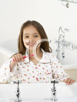 Royalty Free Photo of a Girl Brushing Her Teeth