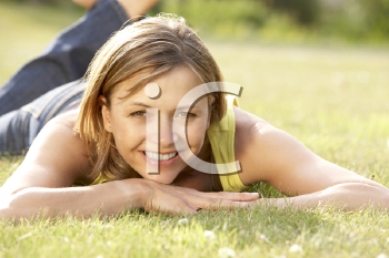 Royalty Free Photo of a Woman Lying on the Grass