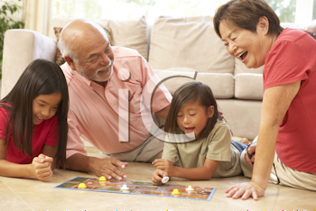 Royalty Free Photo of Grandparents Playing With Grandchildren