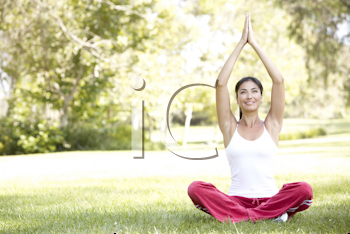 Royalty Free Photo of a Woman Doing Yoga Outside