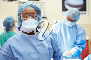 Portrait Of Surgeon Working In Operating Theatre