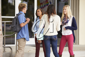 Group Of High School Students Standing Outside Building