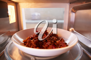 Leftover Chili Cooking Inside Microwave Oven