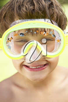 Head And Shoulders Portrait Of Boy Wearing Swimming Mask
