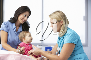 Doctor In Surgery Giving Baby Girl Injection