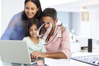 Family Working At Laptop With In Home Office