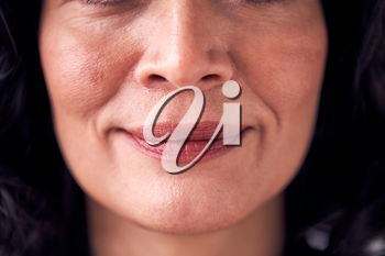 Close Up On Mouth Of Smiling Mature Woman In Studio