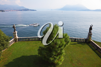 Terrace, adorned with sculptures, on the embankment. Park on the island of Isola Bella on Lake Maggiore