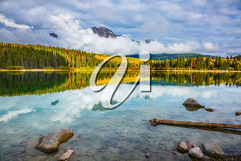 Autumn in the Rocky Mountains. Patricia Lake amongst the forests, yellow bushes and mountains