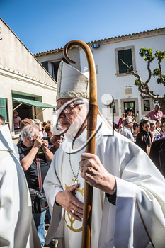 Saint-Marie-de-la-Mer, Provence, France - May 25, 2015. World Festival of Gypsies. The religious procession in honor of the Holy Mary and St. Sara begins. Participants and guests of the city