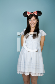 Royalty Free Clipart Image of a Brunette Wearing Mouse Ears