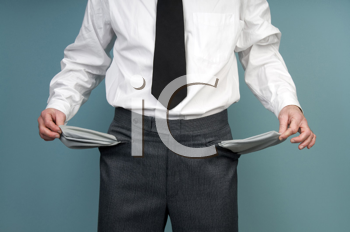 Royalty Free Photo of a Man Holding Empty Pockets