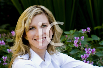 Royalty Free Photo of a Woman in a Garden Smiling