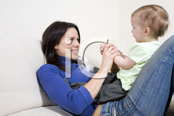 Royalty Free Photo of a Mother Playing With Her Child