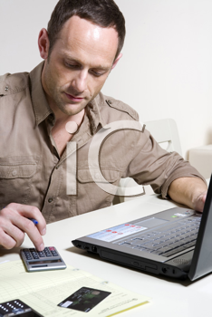 Royalty Free Photo of a Man Paying Bills Online