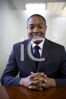 Royalty Free Photo of a Businessman at a Desk