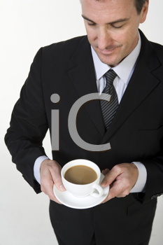 Royalty Free Photo of a Businessman With Coffee