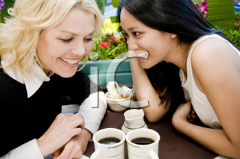 Royalty Free Photo of Two Women Gossipping in a Cafe