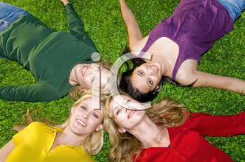Royalty Free Photo of a Group of Women Lying in a Circle