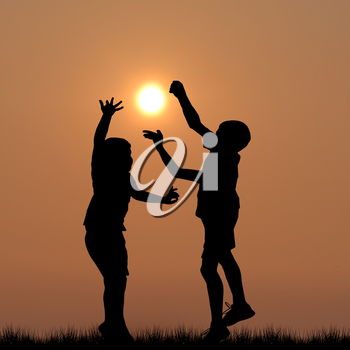 Children silhouettes playing with the sun