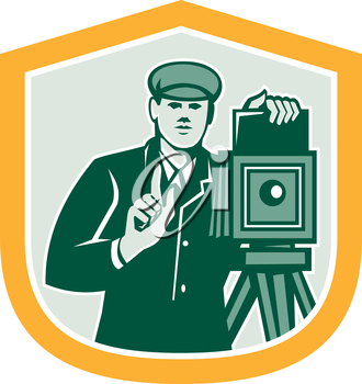 Illustration of a photographer shooting with vintage bellows camera viewed from the front set inside shield crest on isolated white background done in retro style.
