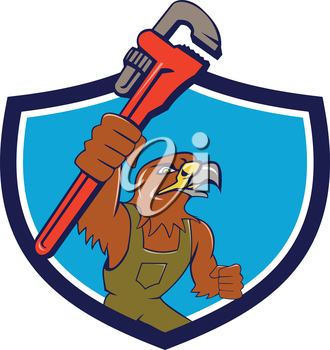Illustration of a hawk mechanic raising up pipe wrench spanner set inside shield crest on isolated background done in cartoon style.