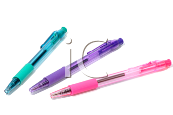 A set of transparent colored pens on a white background, isolated.
