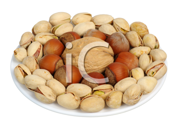 Pistachios, walnuts, hazelnuts on a white background, isolated