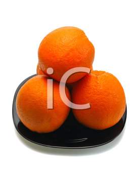 Four oranges and their reflection on a black plate on a white background