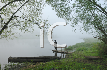 Royalty Free Photo of a Fisherman in the Fog