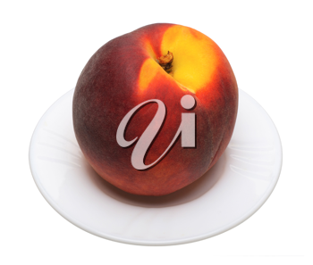 Ripe peach on a plate on a white background, isolated.