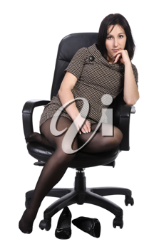 Girl in brown dress sitting in an office chair, isolated on a white background.