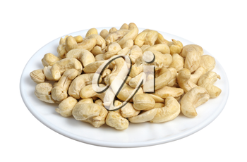 Cashew nuts in a white plate on a white background, isolated