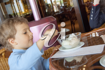 boy child cute eating ice cream in cafe