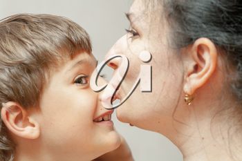 Happiness of mother and little son. Kissing