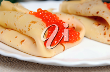 pancakes with red caviar on the plate