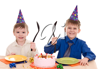 two happy boy with a cake isolated on white background