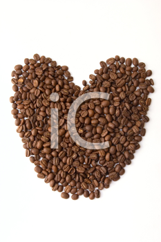Coffee beans as heart on white background