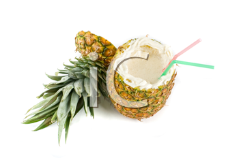 Milk cocktail with pineapple as cup on a white