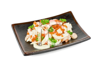 Seafood salad ar plated isolated on a white background