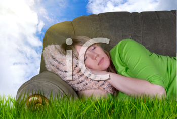 Royalty Free Photo of a Woman Sleeping on a Couch Outdoors