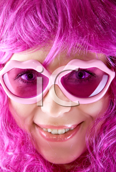 Royalty Free Photo of a Woman Wearing Pink Glasses and Wig