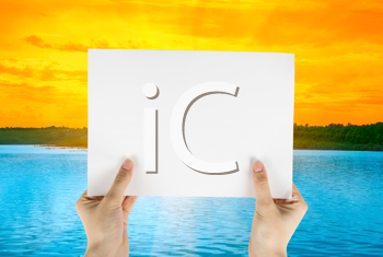 Royalty Free Photo of a Person Holding a Piece of Paper at Sunset