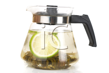 Teapot with green tea and lime isolated on a white background