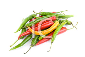 colored chili peppers isolated on white background