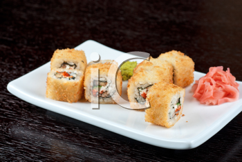 Sushi rolls made of rice, smoked eel, cream cheese and flying fish roe - tobiko caviar