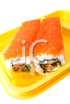 Rolls of sushi at yellow table on white